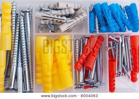 Screws And Plugs In Plastic Toolbox, Top View