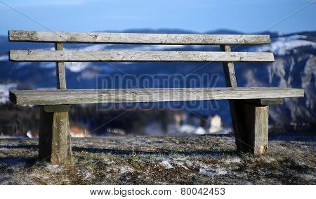 Wooden Bench Isolated In The Mountain