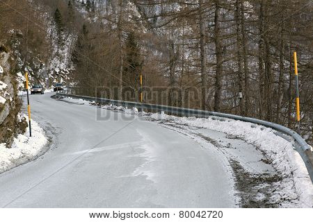 Curve Of A Frozen Mountain Road In Winter