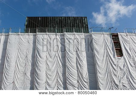 Wrapped building at construction site