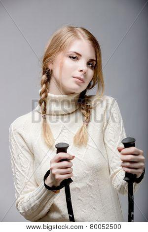 girl portrait with ski sticks