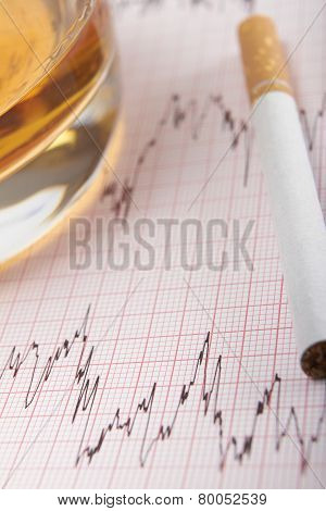 Glass Of Whiskey And Cigarette On Ecg Printout