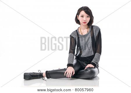 portrait of beautiful young woman, sitting on floor