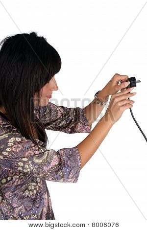 Woman plugging electric cord