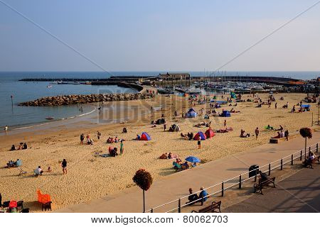 Lyme Regis Dorset coast UK tourists and visitors enjoy the late summer sunshine