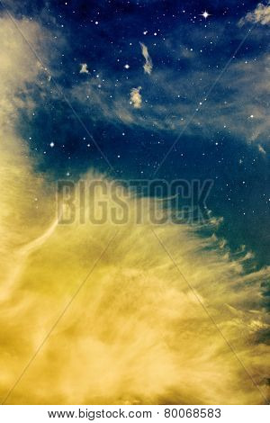 Wispy Yellow Clouds And Stars