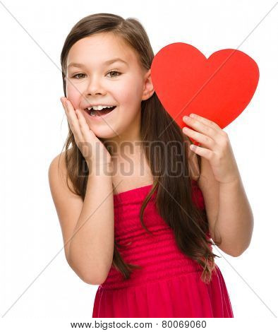 Little girl with red heart, holding her face in astonishment, Valentine concept, isolated over white