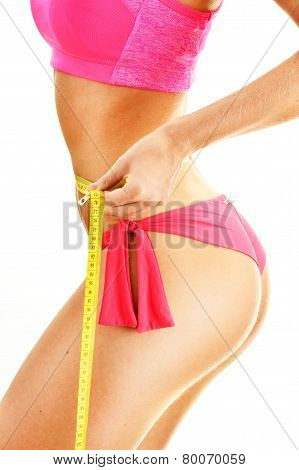 Sexy Young Woman Measuring Herself. Weight Loss