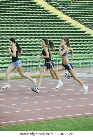 Girls Running On Athletics Race Track