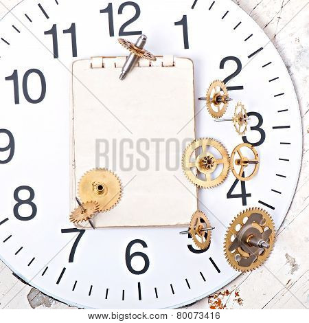 paper and old mechanical clock gears