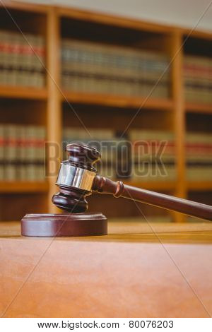 Gavel resting on sound block in library