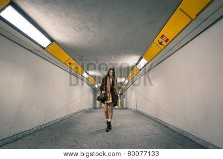 Beautiful Young Woman Posing In A Subway Underpass