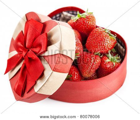 Fresh strawberries in box with bow gift on valentines day. Isolated on white background