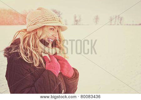 Happy Woman In Snow Looking Aside Or To Someone