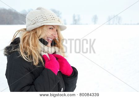 Winter Happy Woman In Snow Looking Aside Or To Someone