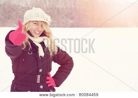 Winter Happy Woman In Snow Looking Up At Camera