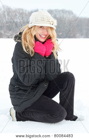 Winter Happy Woman In Snow Looking Up At Camera Outside
