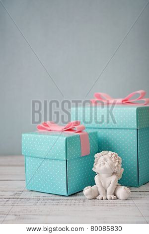 Gift Boxes With Statuette Of Angel