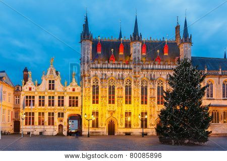 Cityscape with the picturesque Christmas Burg Square in Bruges