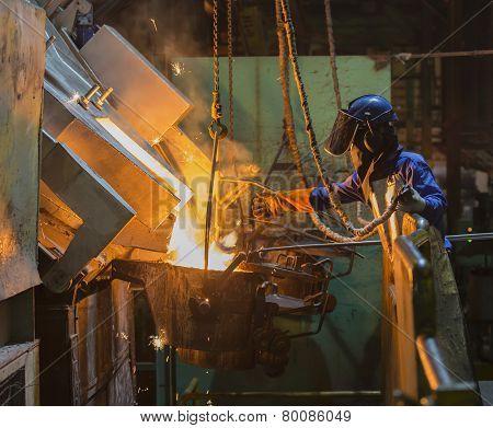 Operator Recieve Molten Metal