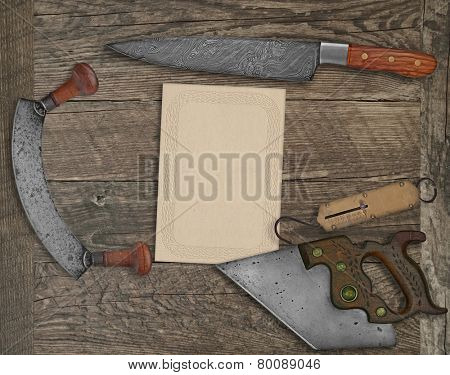 vintage kitchen knives and utensils over wooden board board, blank card for your text