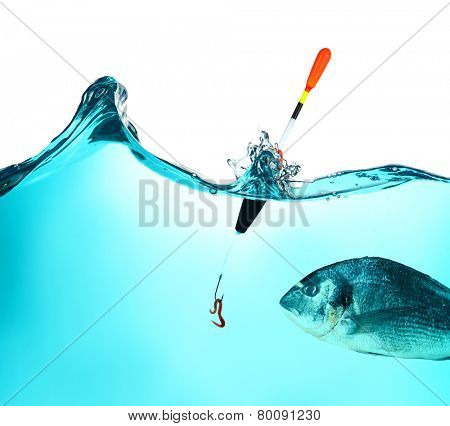 Fish hook with worm in water