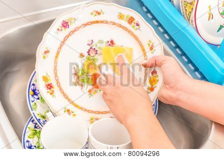 Domestic chores - Washing the dishes in the kitchen sink