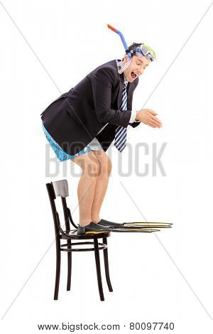Businessman with snorkel jumping off a chair isolated on white background