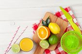 foto of fruit-juice  - Citrus fruits and glass of juice - JPG