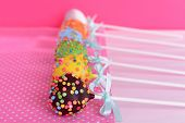 stock photo of cake pop  - Sweet cake pops on table on pink background - JPG