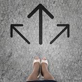 foto of crossroads  - Top view of businesswoman feet standing at crossroads - JPG