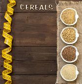 pic of cereal bowl  - Cereals in bowls with word Cereals and measuring tape on wood - JPG