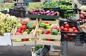 stock photo of crate  - Fresh organic food piles sold on market from crates - JPG