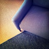 stock photo of carpet  - Blue textile armchair and knitted carpet - JPG