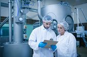 picture of food  - Food technicians working together in a food processing plant - JPG