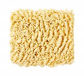 stock photo of noodles  - A block of uncooked Ramen Noodles isolated on white - JPG