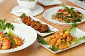 picture of thai food  - Varieties of Thai foods and appetizers covering a table - JPG