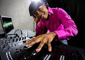 stock photo of rapper  - Cool African American male DJ playing music at a party - JPG