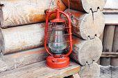 stock photo of kerosene lamp  - Kerosene lamp on wooden hose background - JPG