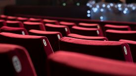 foto of cinema auditorium  - Empty theater with red chairs. Rear view. ** Note: Shallow depth of field - JPG