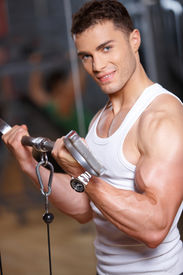 stock photo of fitness man body  - Handsome man at the gym doing exercises - JPG