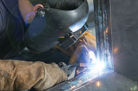 pic of welding  - operator welding steel construction by MIG welding machine - JPG
