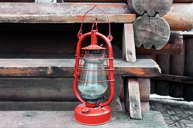 image of kerosene lamp  - Kerosene lamp on wooden stairs - JPG
