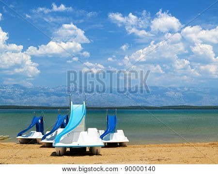 Colorful pedalos on a beautiful tropical beach