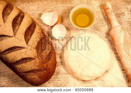Homemade Baking. Fresh Dough For Pastry, Kitchen Rolling Pin, Bread, Broken Eggs On A Chopping Board