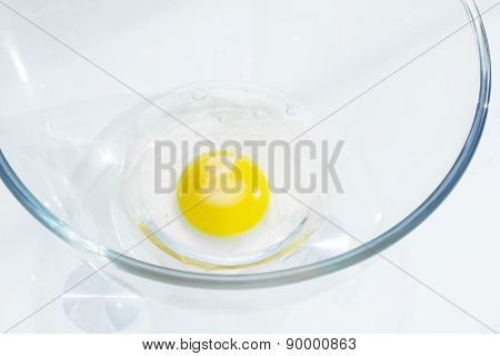 Raw egg in a bowl