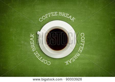 Coffee break text on blackboard with coffee cup