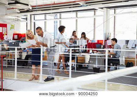 Staff working in a busy office mezzanine