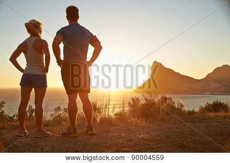 Man and woman contemplating after jogging