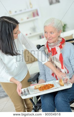 Giving old lady her lunch